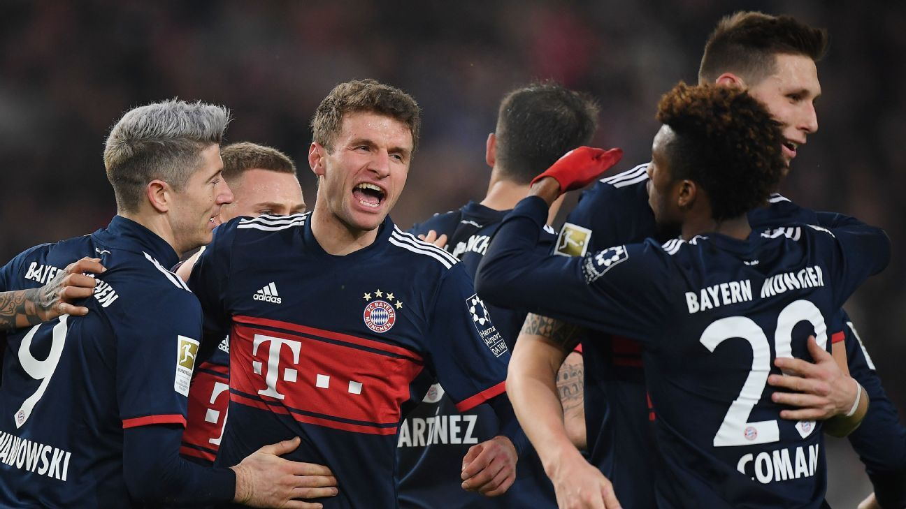 Thomas Muller celebrates after scoring for Bayern Munich against Stuttgart.