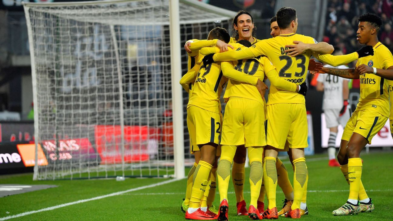 PSG players celebrate a goal in Ligue 1 against Rennes.