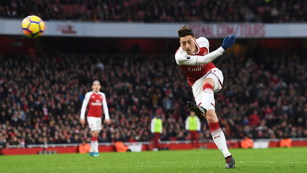 Mesut Ozil scores for Arsenal during their Premier League win against Newcastle.