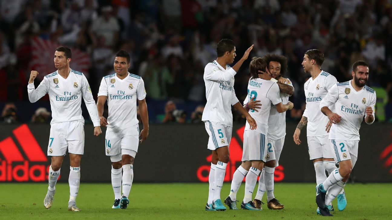 Real Madrid players celebrate during their game against Gremio.
