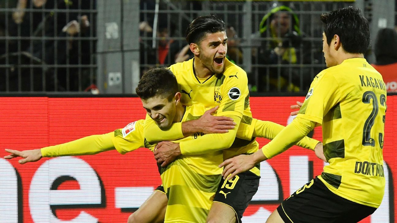 Christian Pulisic is congratulated by his Borussia Dortmund teammates after scoring against Hoffenheim.