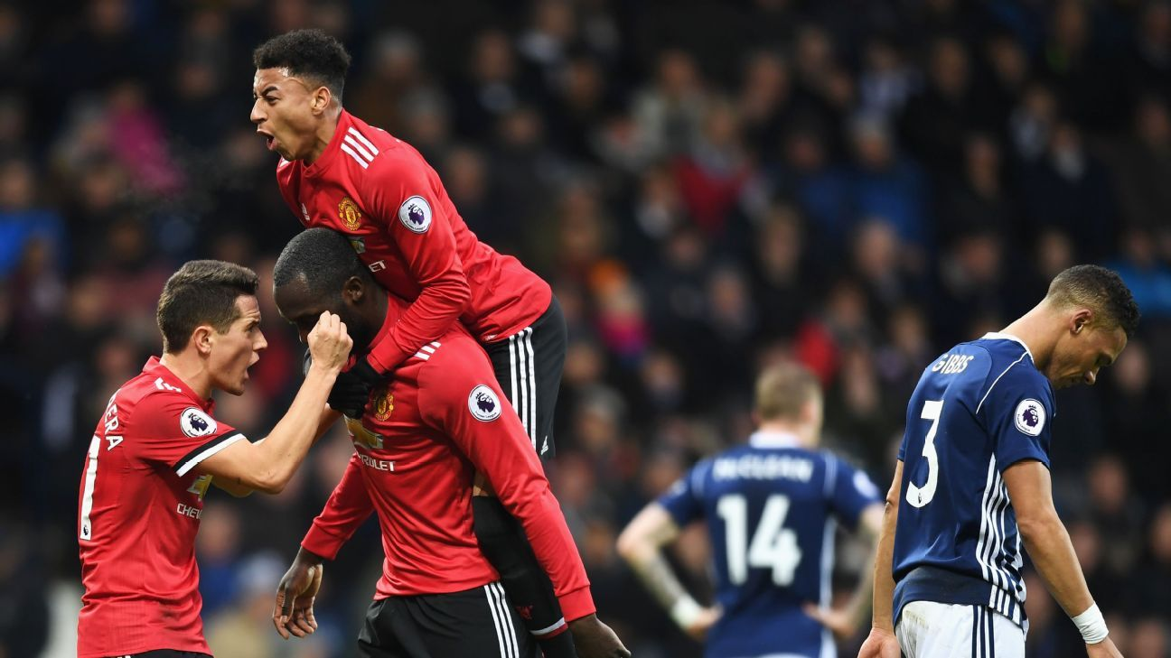 Manchester United players celebrate during their Premier League game against West Brom.