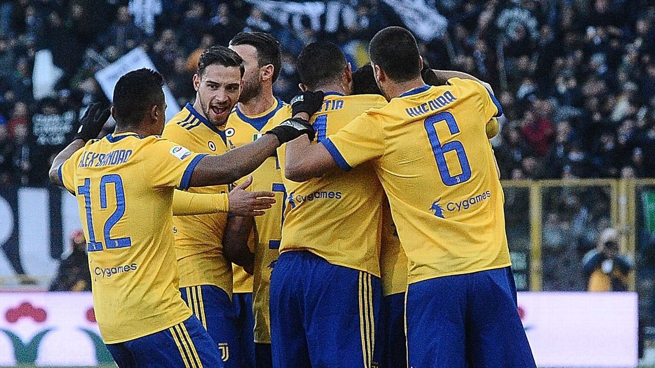 Juventus players celebrate after scoring against Bologna.