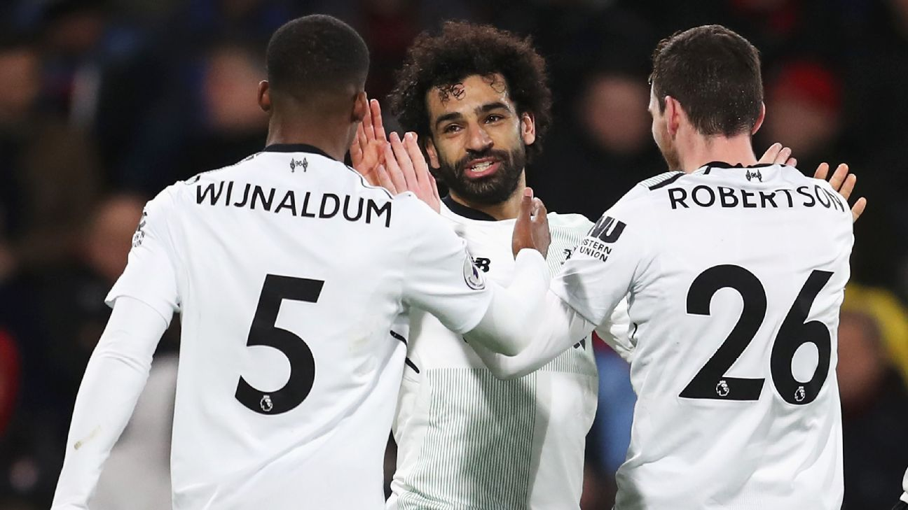 Mohamed Salah, centre, celebrates his goal and Liverpool's third in a 4-0 win at Bournemouth.