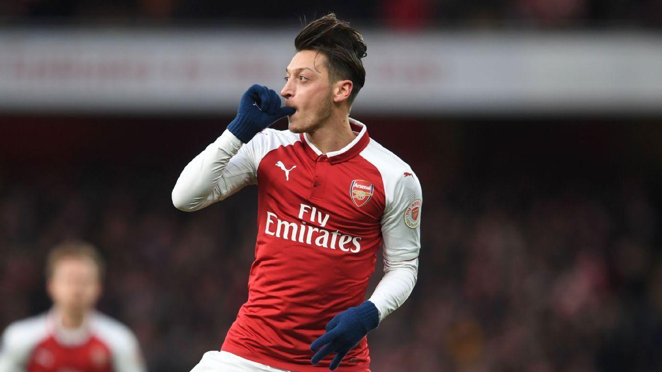 Mesut Ozil celebrates after scoring for Arsenal against Newcastle.