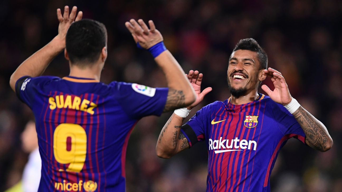Luis Suarez celebrates with Paulinho after scoring Barcelona's opening goal against Deportivo la Coruna.