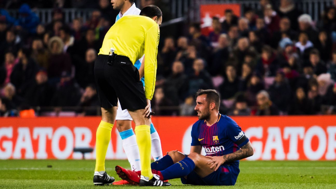 Paco Alcacer sits on the pitch after picking up an injury against Deportivo La Coruna.