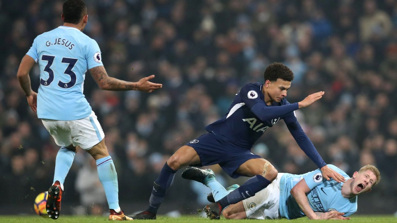 Dele Alli tackles Kevin De Bruyne during Tottenham's Premier League win over Tottenham.