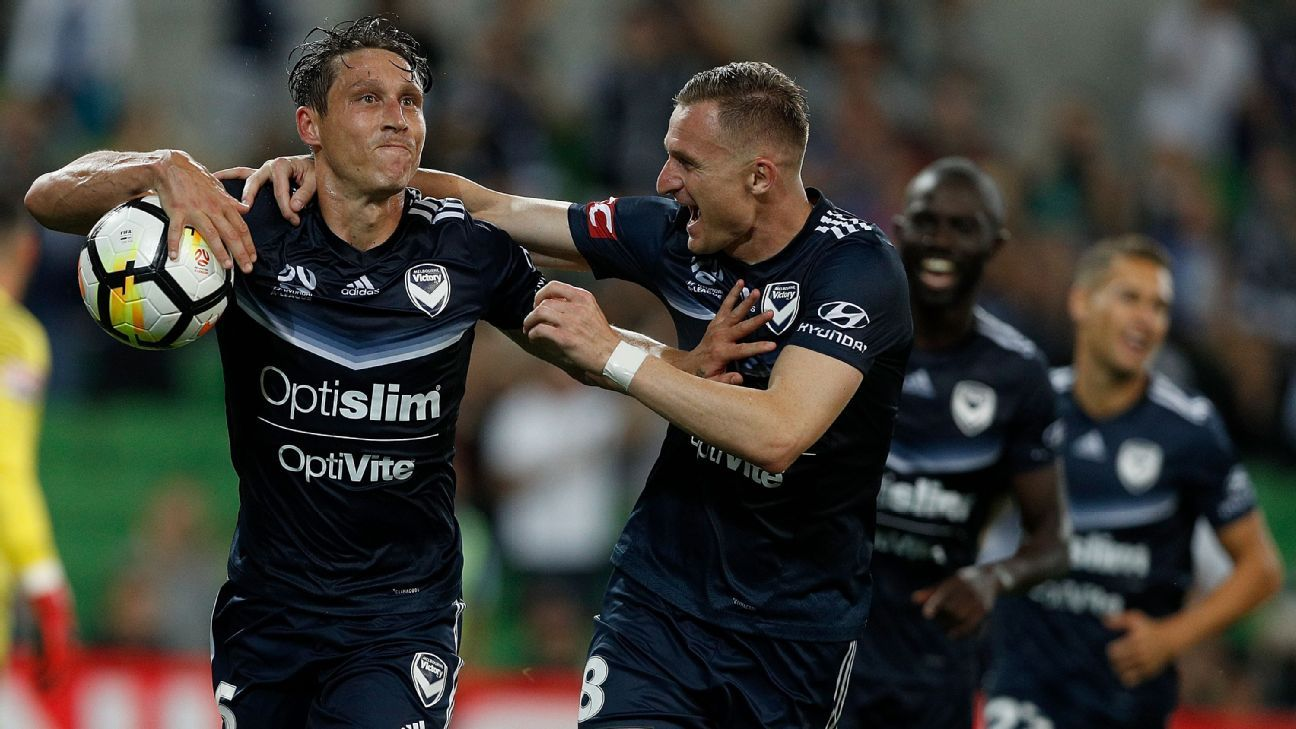 Mark Milligan celebrates after scoring for Melbourne Victory against Melbourne City.