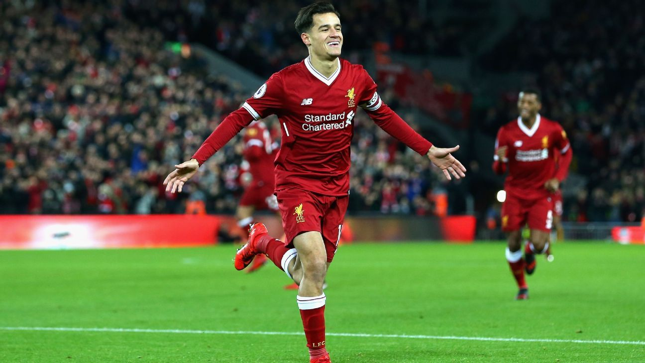 Philippe Coutinho celebrates after scoring against Swansea.