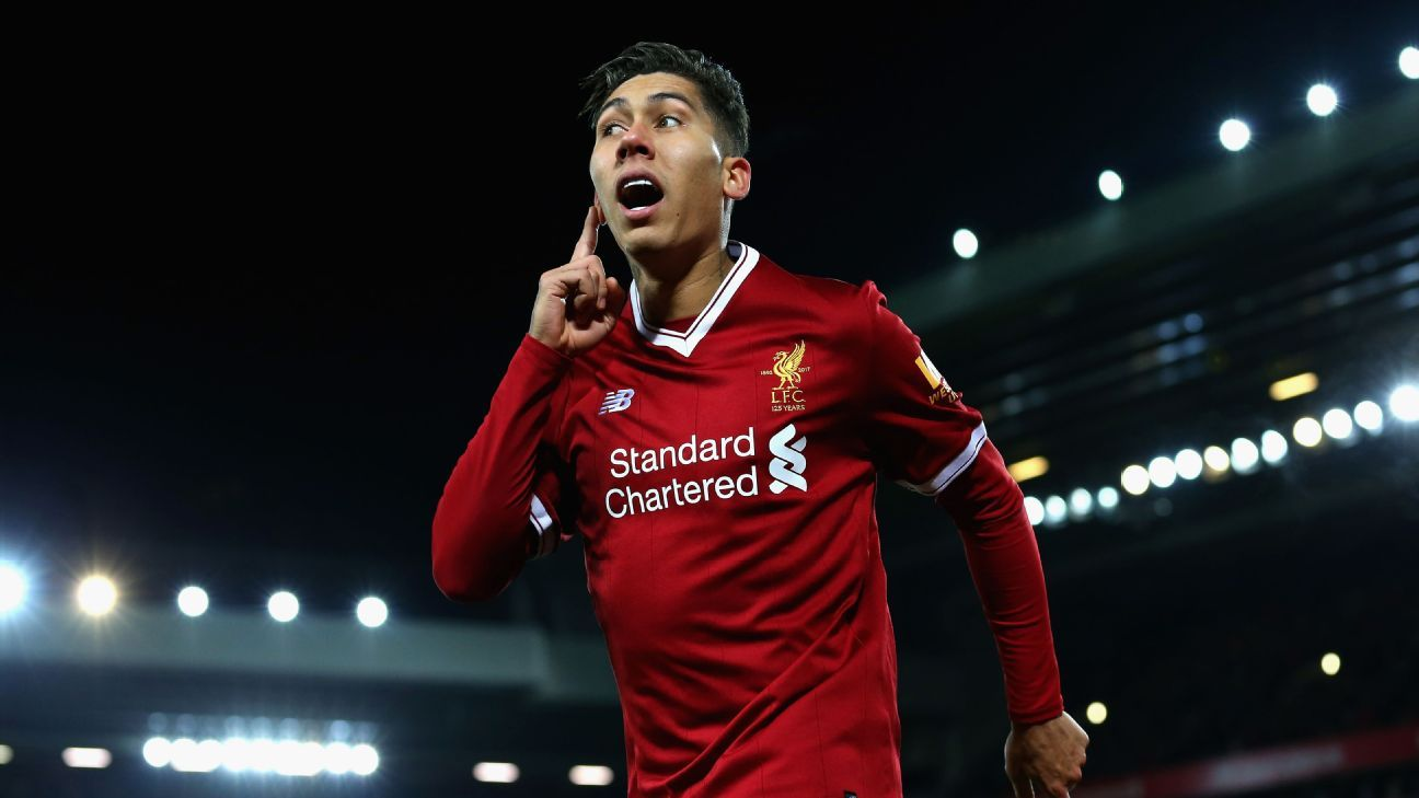 Roberto Firmino celebrates after scoring for Liverpool against Swansea.