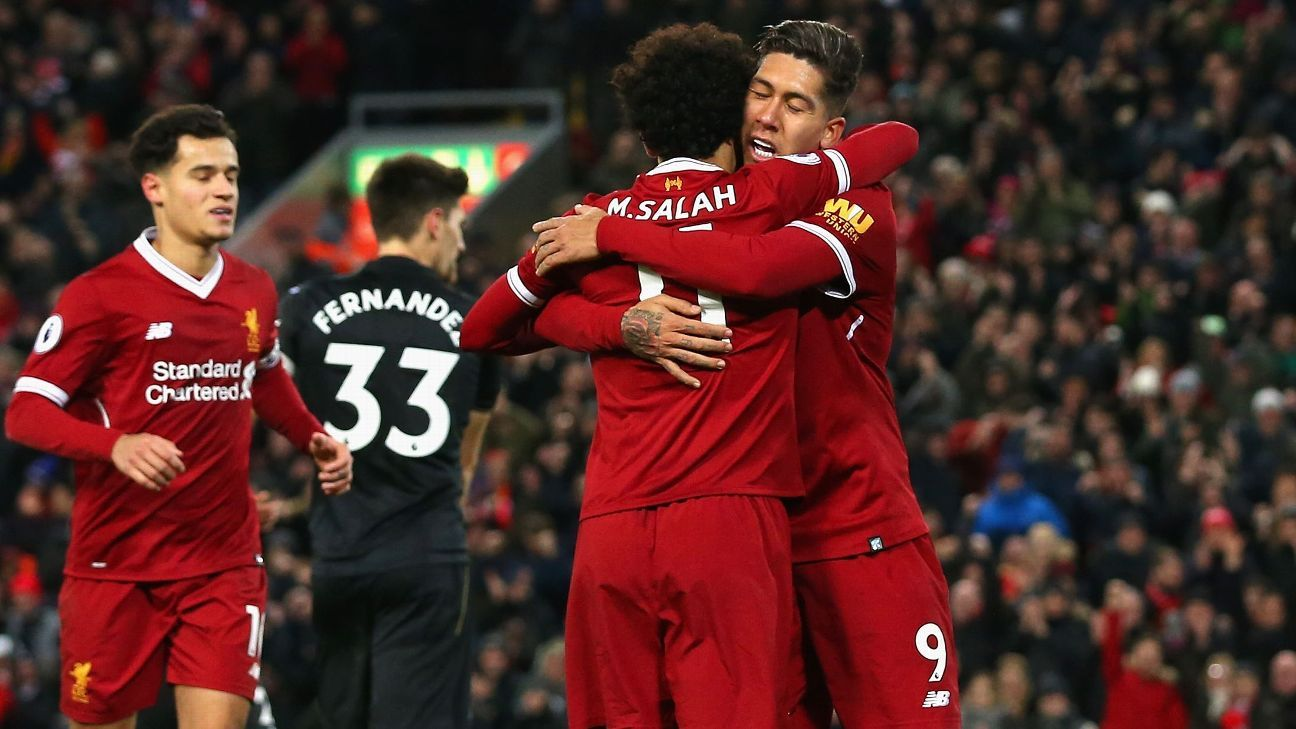 Roberto Firmino and Mohamed Salah celebrate a Liverpool goal vs. Swansea.