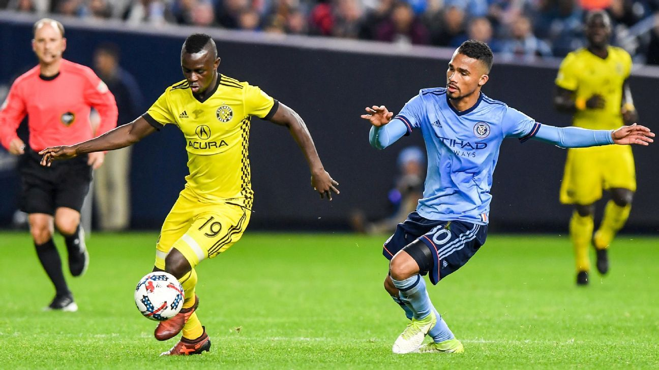 Kekuta Manneh dribbles past a New York City FC defender.