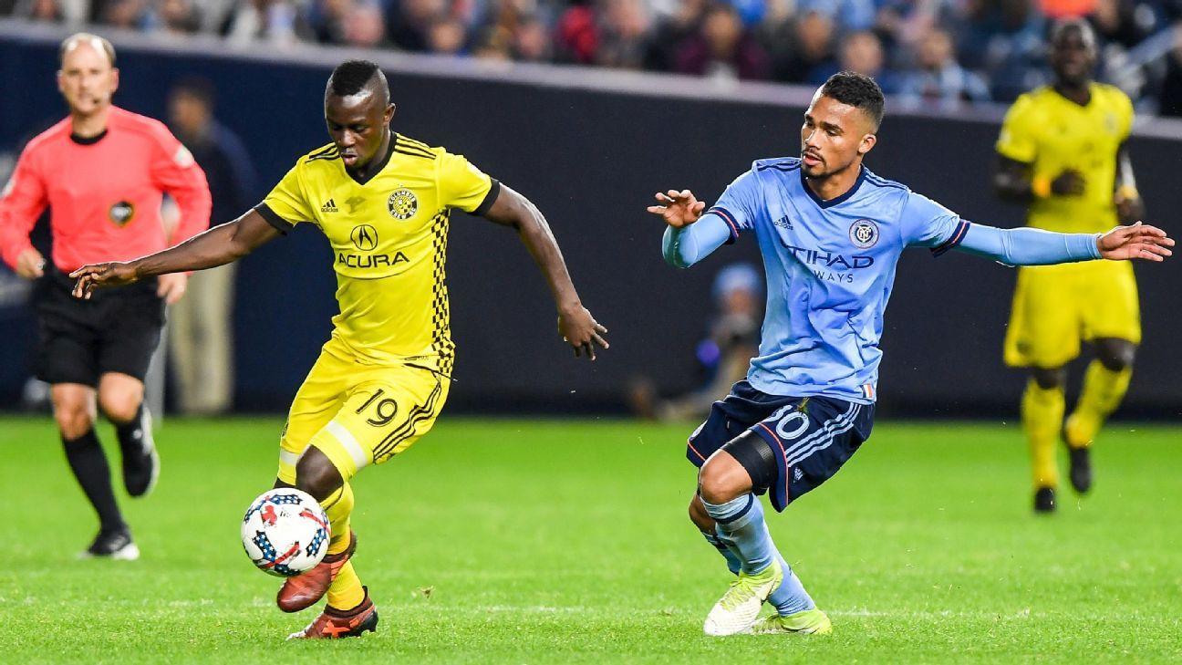 Kekuta Manneh dribbles past a New York City FC defender.