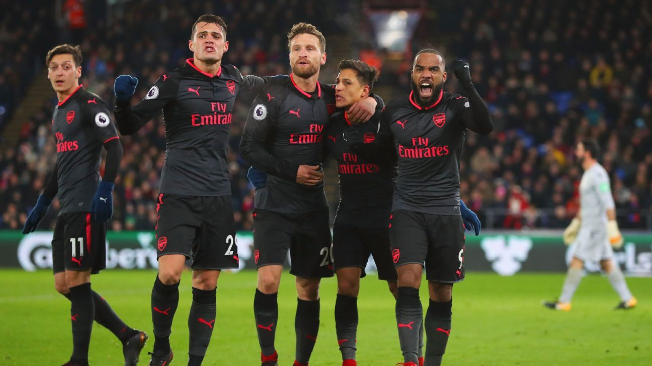 Arsenal players celebrate after and Alexis Sanchez goal goal against Crystal Palace.