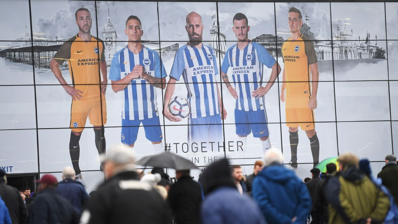 Fans walk towards the ground prior to the Premier League match between Brighton and Hove Albion and AFC Bournemouth at Amex Stadium.