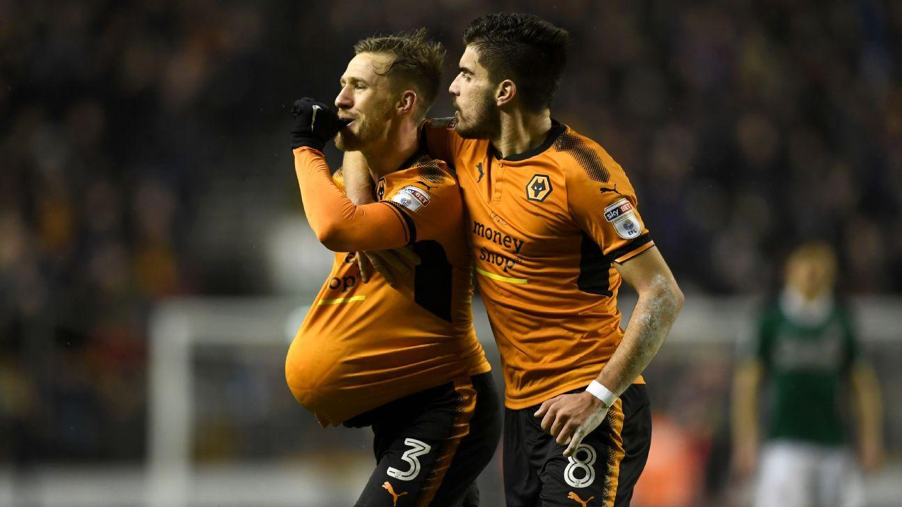 Barry Douglas celebrates after scoring a goal for Wolves against Brentford.