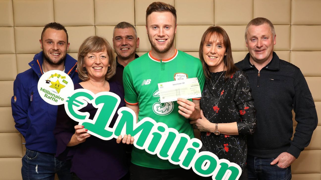 Preston North End's Kevin O'Connor celebrates winning Irish lottery with his family