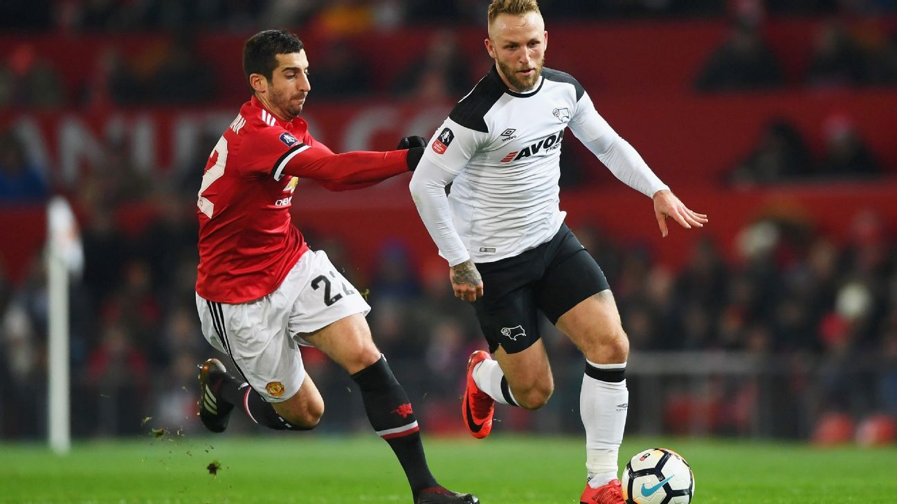 Johnny Russell of Derby County is chased by Henrikh Mkhitaryan of Manchester United during their Emirates FA Cup Third Round match.