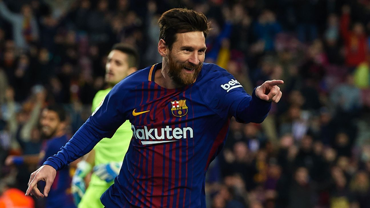 Lionel Messi celebrates after scoring against Levante.