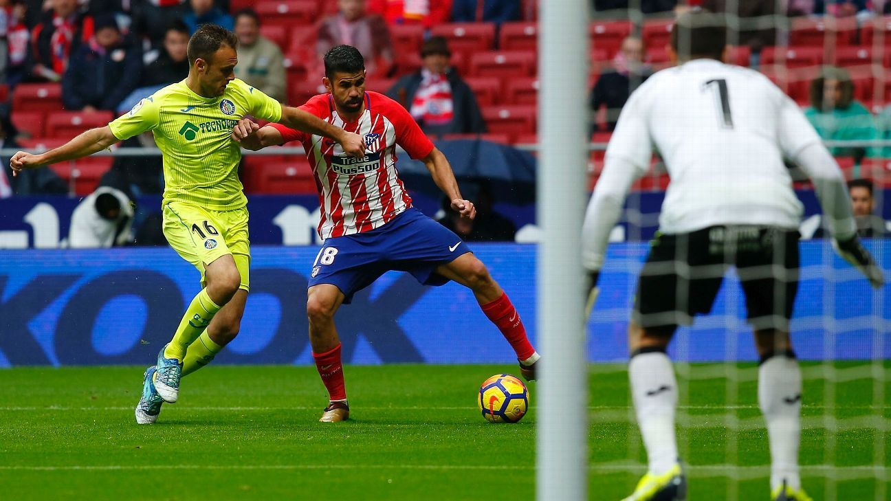 Diego Costa and Cala battle for possession during Atletico Madrid's La Liga victory against Getafe.