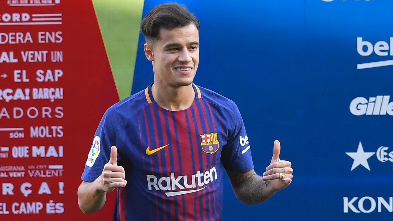 Philippe Coutinho waves to fans from Camp Nou pitch after completing move to Barcelona