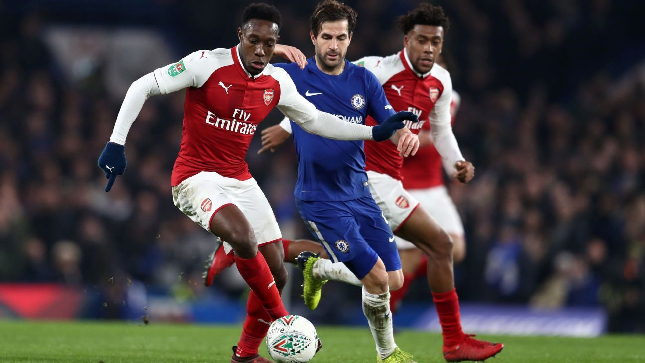 Danny Welbeck was challenged by Cesc Fabregas during Arsenal's Carabao Cup semifinal first leg against Chelsea but no penalty was given.
