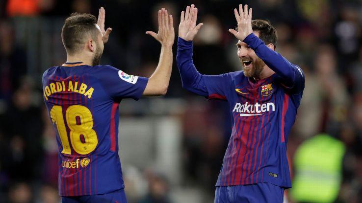 Lionel Messi and Jordi Alba celebrate vs. Celta Vigo.