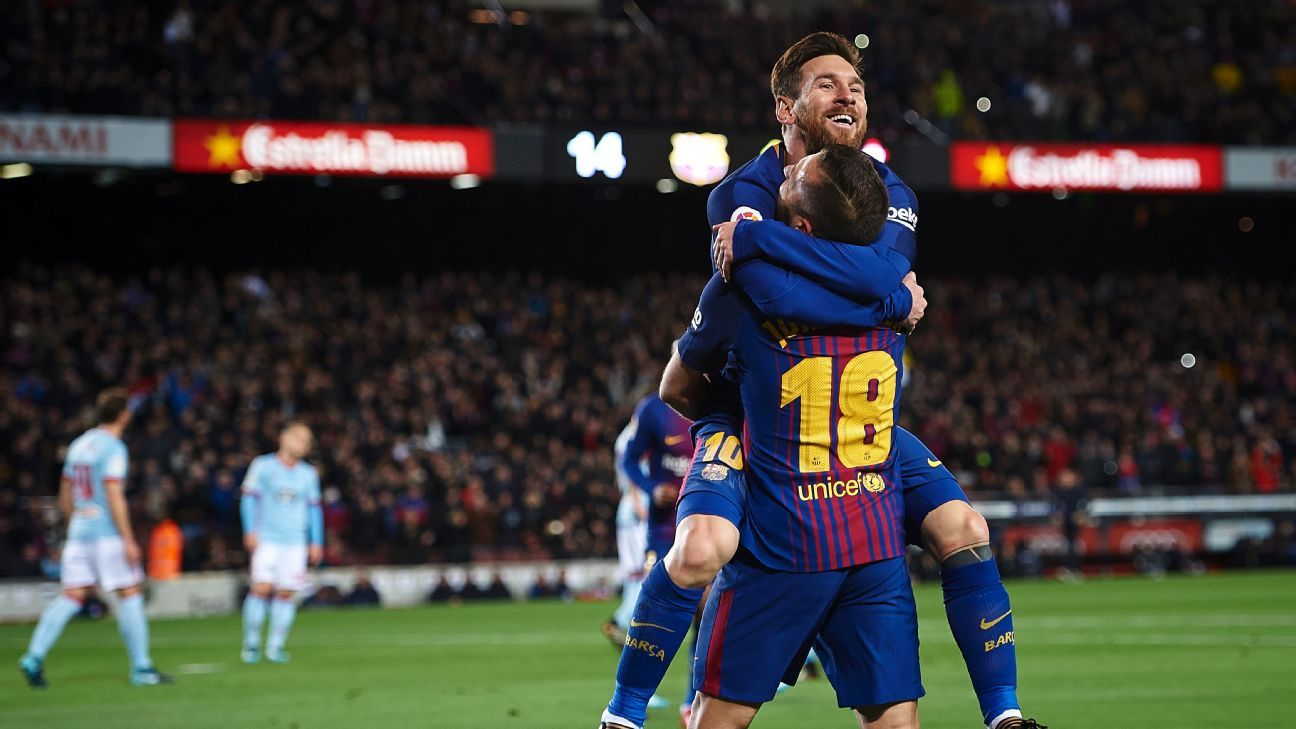 Lionel Messi and Jordi Alba celebrate against Celta Vigo.