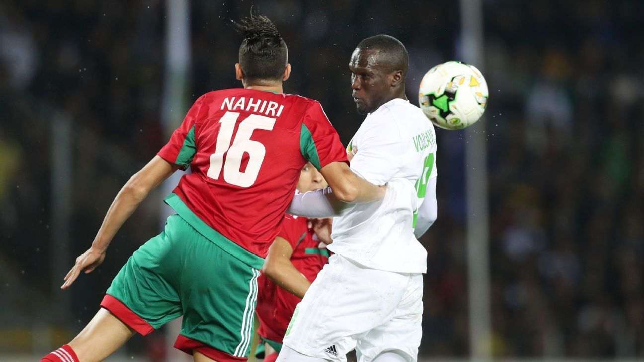 Mohammed Nahiri of Morocco wins header against Cheikh Samba El Voullany of Mauritania
