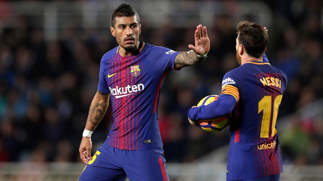 Lionel Messi congratulates Paulinho after scoring a goal for Barcelona.