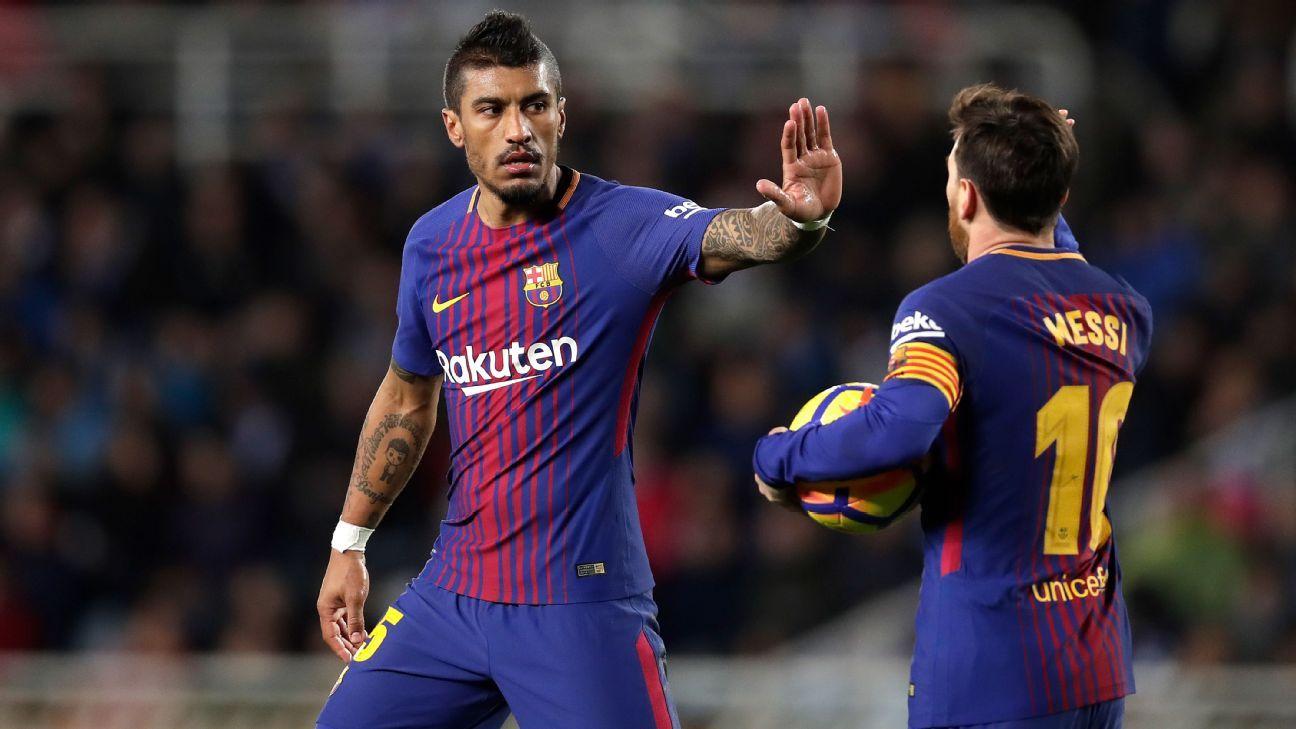 Lionel Messi congratulates Paulinho after scoring a goal for Barcelona.