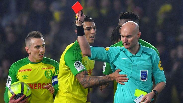 Referee Tony Chapron sends off Nantes player Diego Carlos during Ligue 1 match against Paris Saint-Germain
