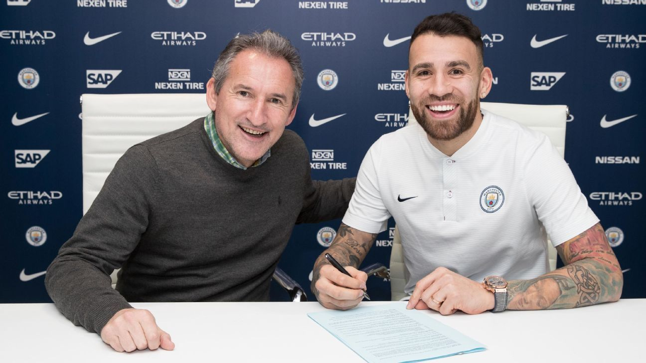 Manchester City defender Nicolas Otamendi signs a contract extension with director of football Txiki Begiristain