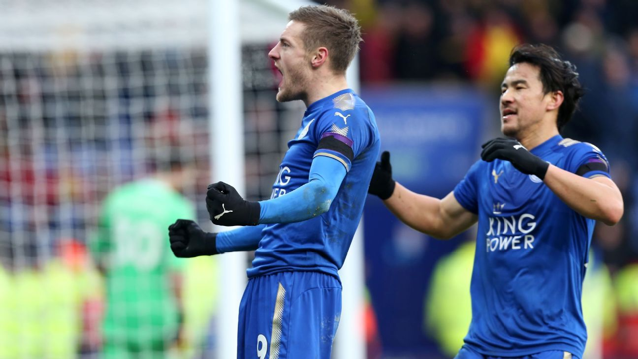 Leicester's Jamie Vardy, left, celebrates scoring the opening goal versus Watford.