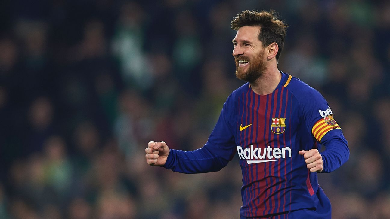 Lionel Messi celebrates after scoring a goal against Real Betis.