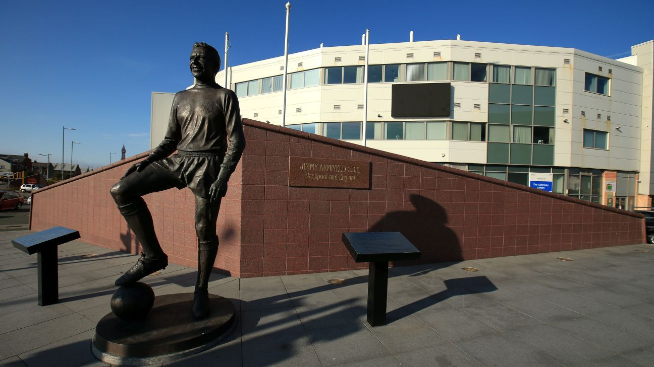 A statue of Jimmy Armfield stands outside Bloomfield Road in Blackpool.