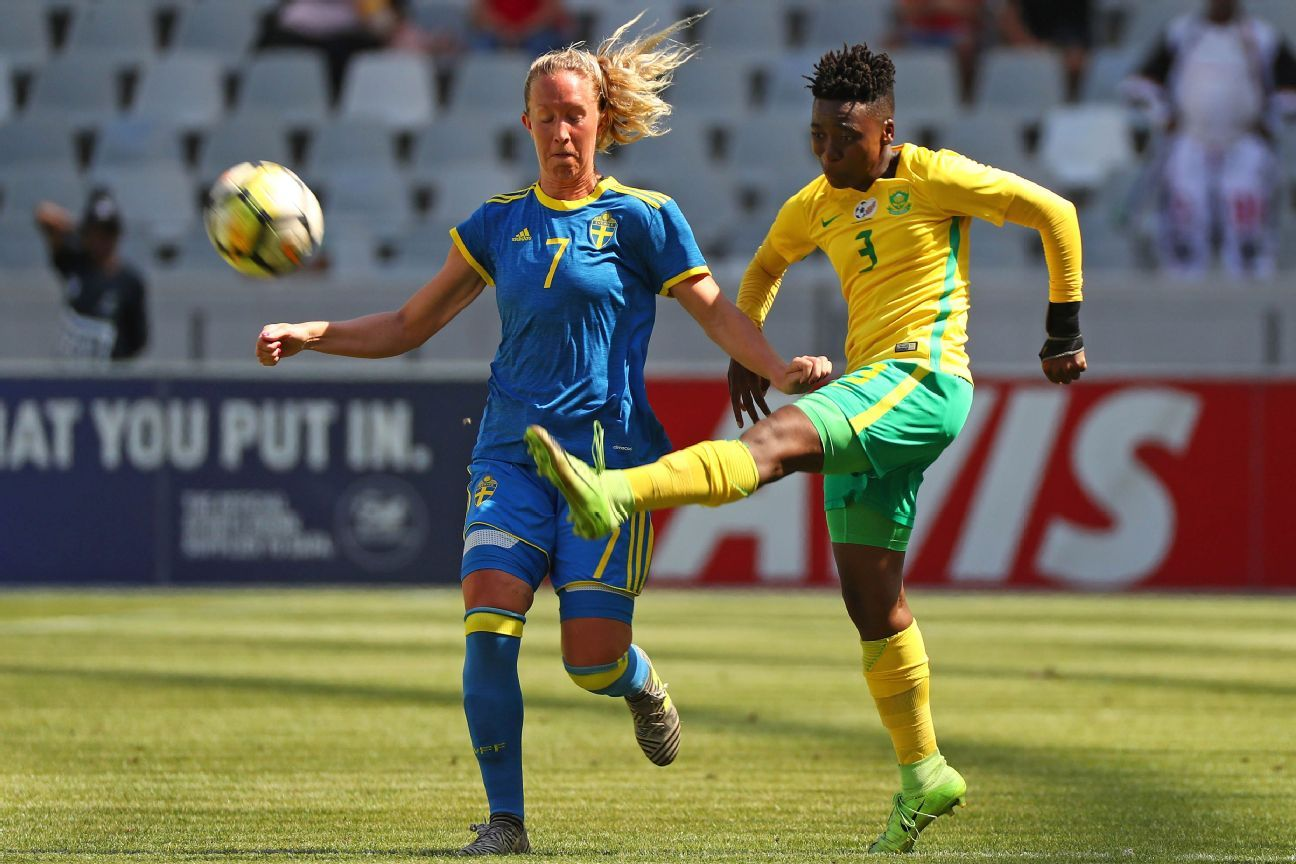 Nothando Vilakazi of South Africa clears ball ahead of Julia Roddar of Sweden during their International Football Friendly at Cape Town Stadium.
