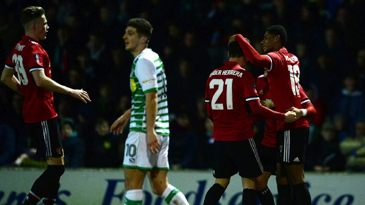 Manchester United players celebrate after scoring a goal against Yeovil Town in the FA Cup.