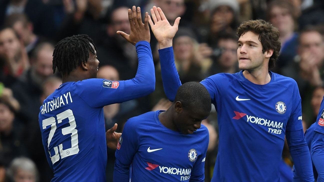 Chelsea's Michy Batshuayi congratulates Marcos Alonso on his goal vs Newcastle