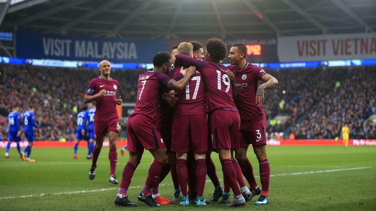 Manchester City players celebrate Kevin De Bruyne's opening goal vs Cardiff