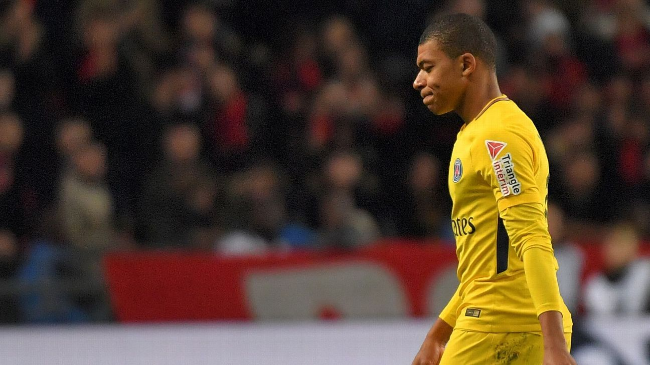 Kylian Mbappe heads for the dressing room after being shown a red card in PSG's win against Rennes.