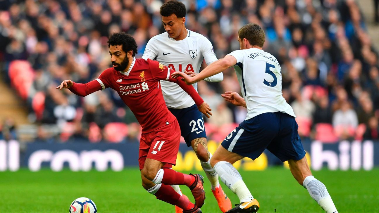 Mohamed Salah dribbles past a pair of Tottenham defenders back in October.