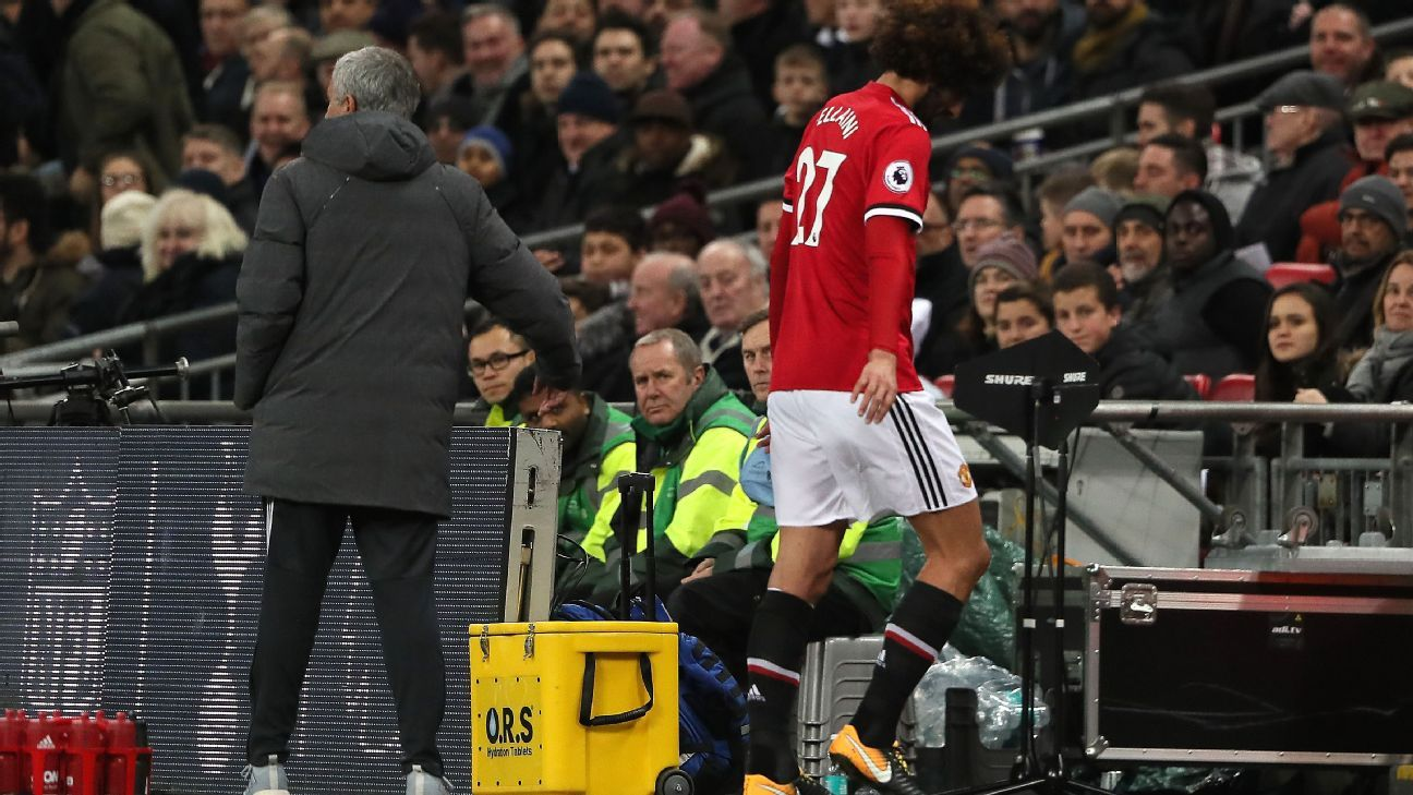 Marouane Fellaini departs the pitch at Wembley.