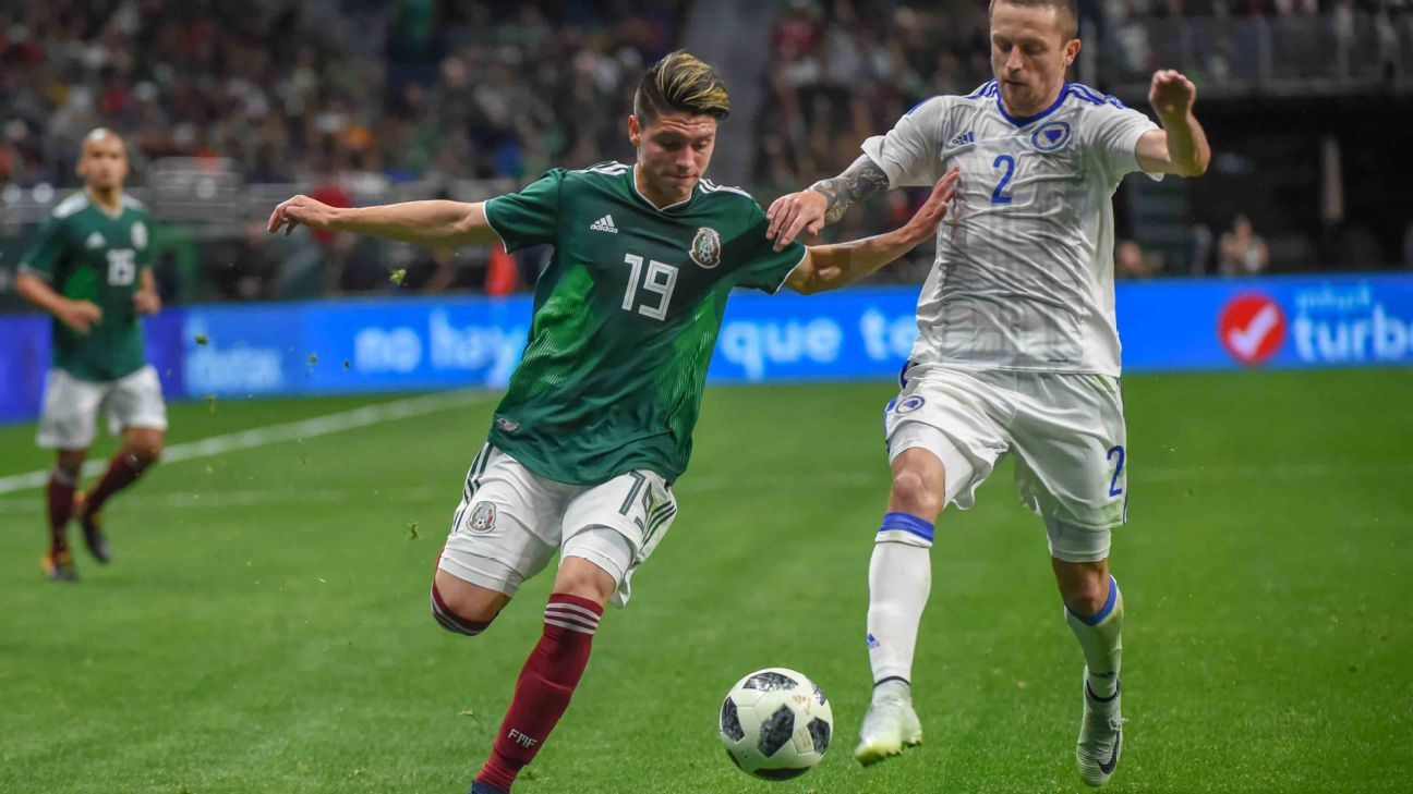 Jonathan Gonzalez battles for the ball in his debut for the Mexico national team against Bosnia and Herzegovina.