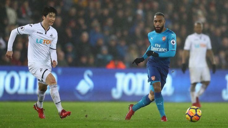Alexandre Lacazette in action against Swansea City in the Premier League.