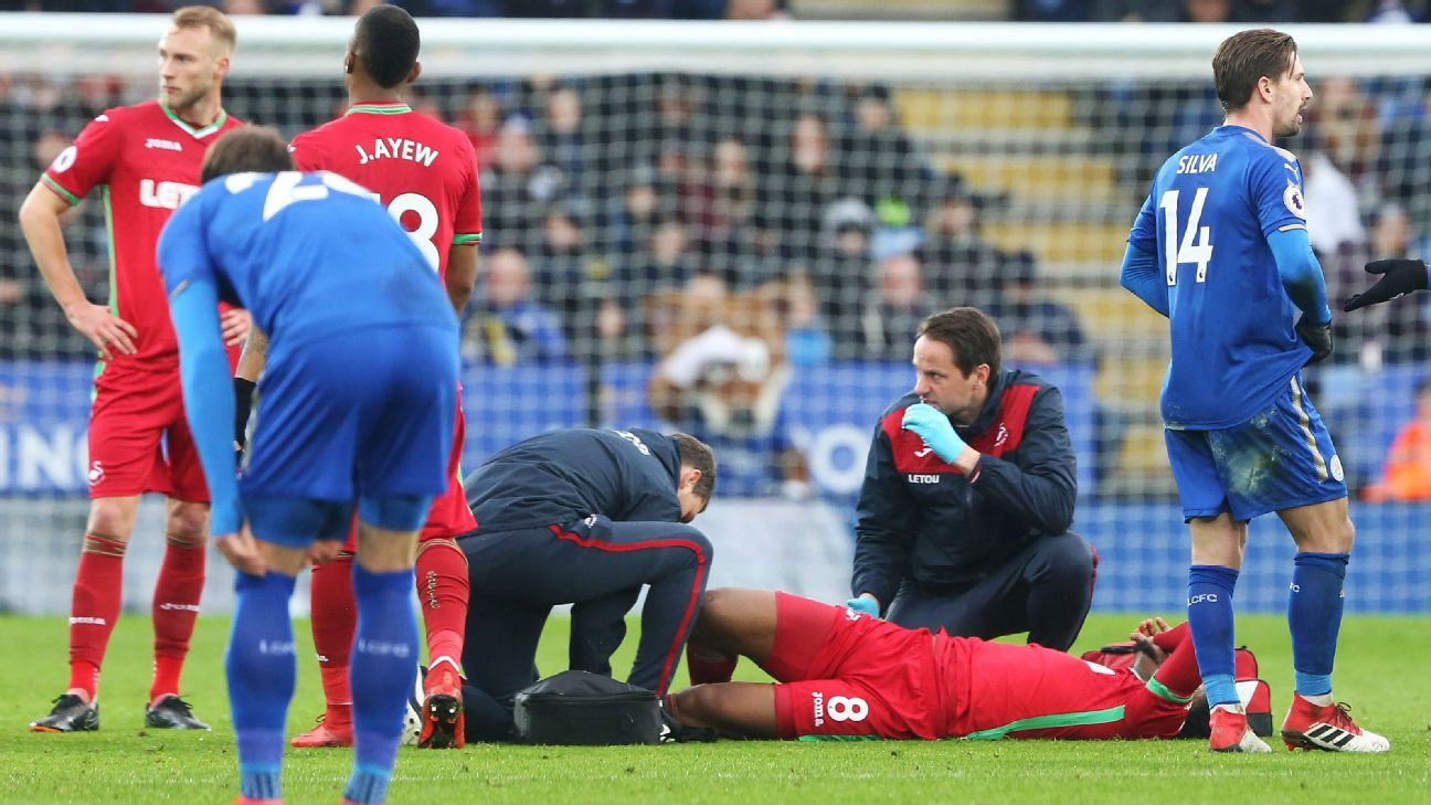 Leroy Fer receives treatment after being injured in Swansea's Premier League game against Leicester.