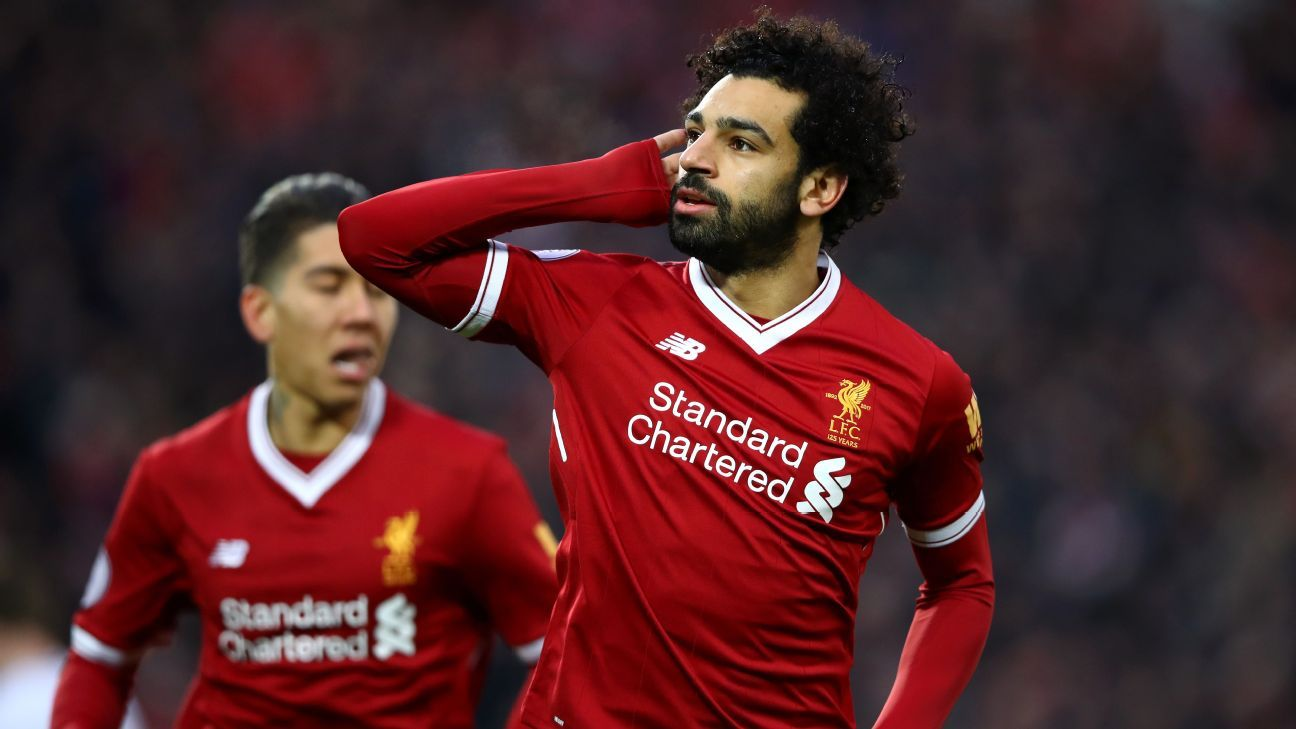 Mohamed Salah celebrates after scoring for Liverpool in their Premier League game against Spurs.