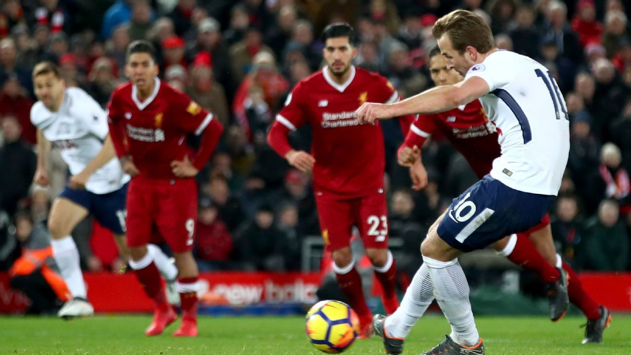 Harry Kane scores his 100th Premier League goal from the penalty spot against Liverpool.