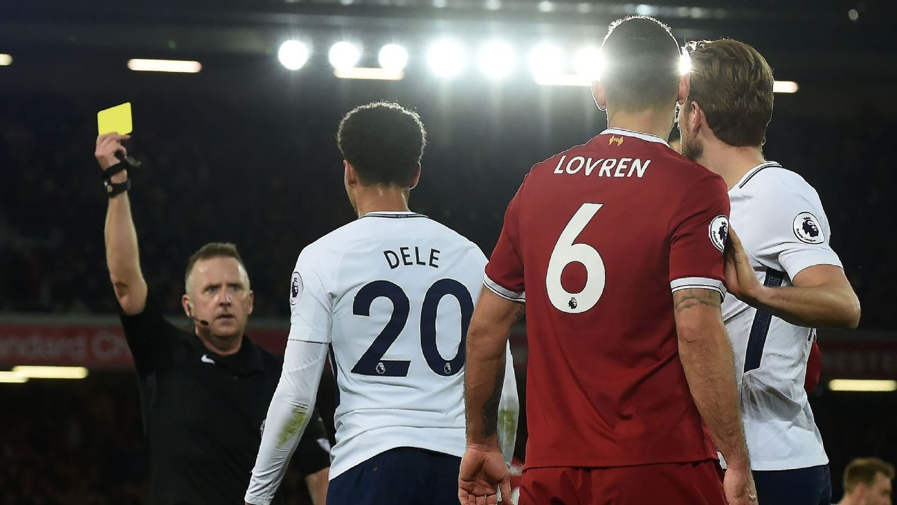 Dele Alli is shown a yellow card for diving in Tottenham's 2-2 draw with Liverpool.
